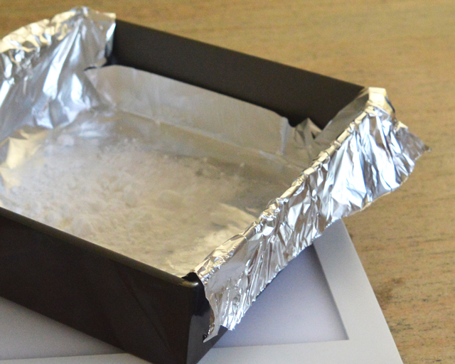Lining a baking tray with foil ready to clean silver